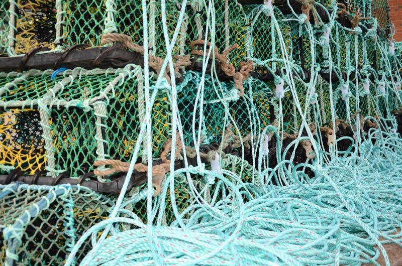 Potes de langosta de Fishermans encendido en el lado del muelle fotografía de archivo libre de regalías