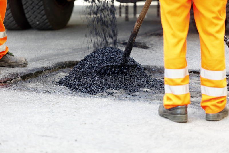 Pothole asphalt repair royalty free stock images