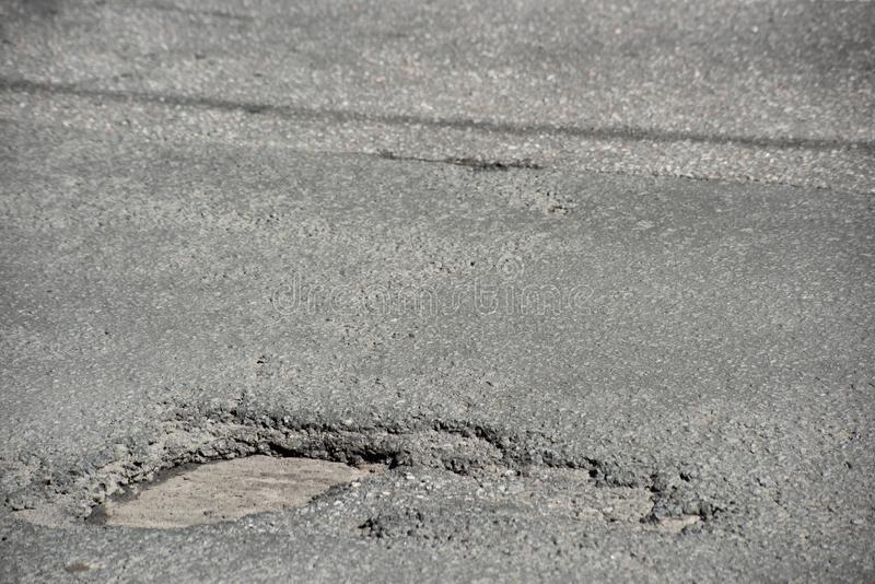 Pothole in the road canvas stock photos
