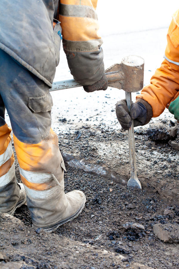 Pothole and road surface repairing. Upgrading pavements and road surfaces stock image