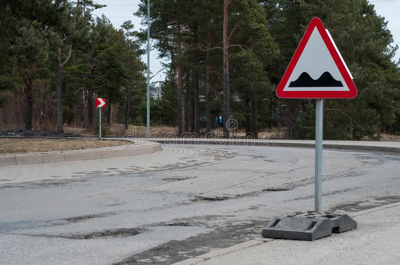 Potholes on the road. Shot of potholes on the road with sign royalty free stock photos