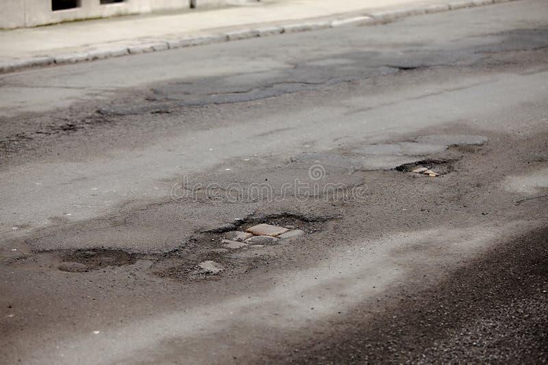 Potholes. Very bad quality road with potholes stock image