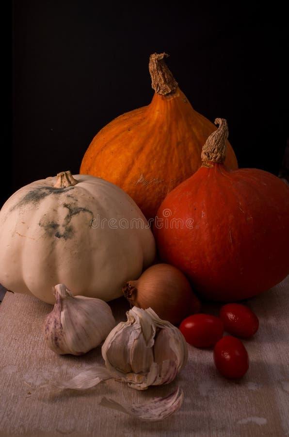 Potirons à l'oignon, à l'ail et aux tomates photo stock
