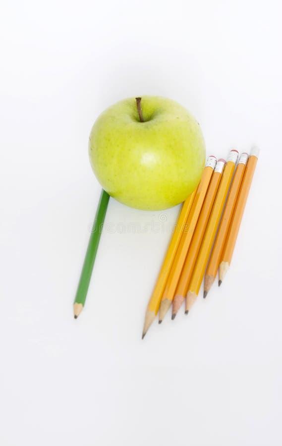 Potloden en appel stock foto's