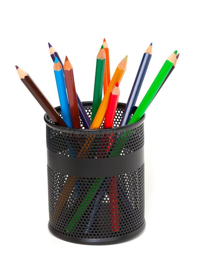 Potloden in potloodhouder stock afbeelding
