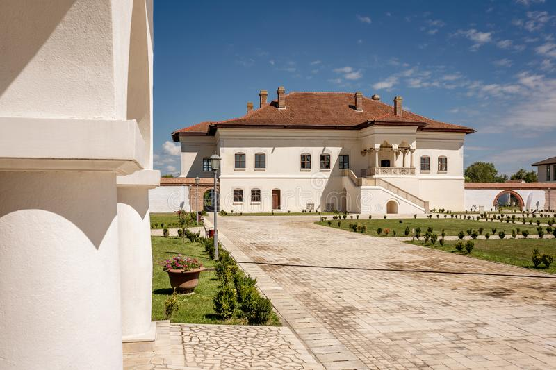 Potlogi, Romania - August 2018: Constantin Brancoveanu Palace an. D it's surrounding garden stock photo