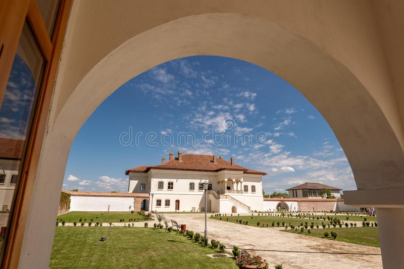 Potlogi, Romania - August 2018: Constantin Brancoveanu Palace an. D it's surrounding garden royalty free stock photography