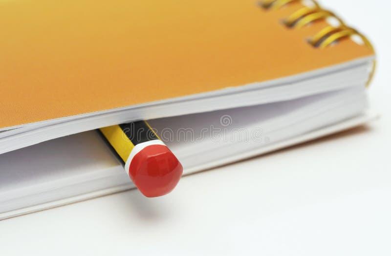 Potlood in een notitieboekje royalty-vrije stock foto