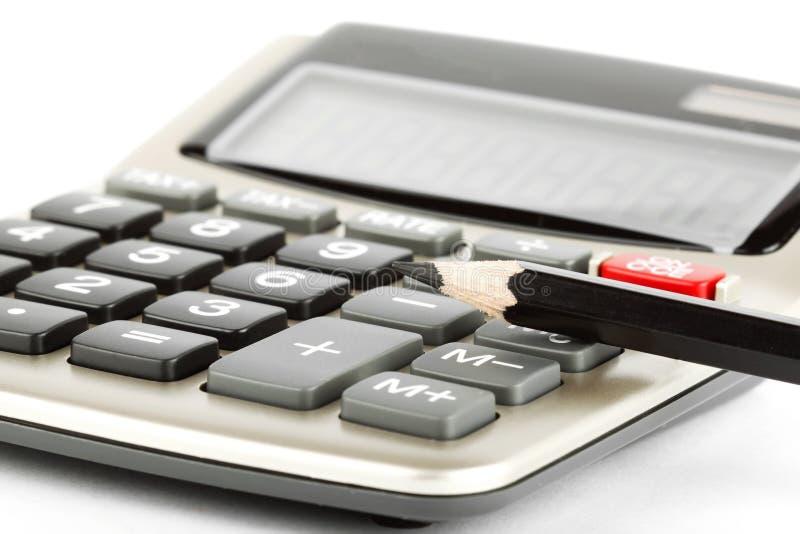 Potlood met calculator royalty-vrije stock afbeeldingen