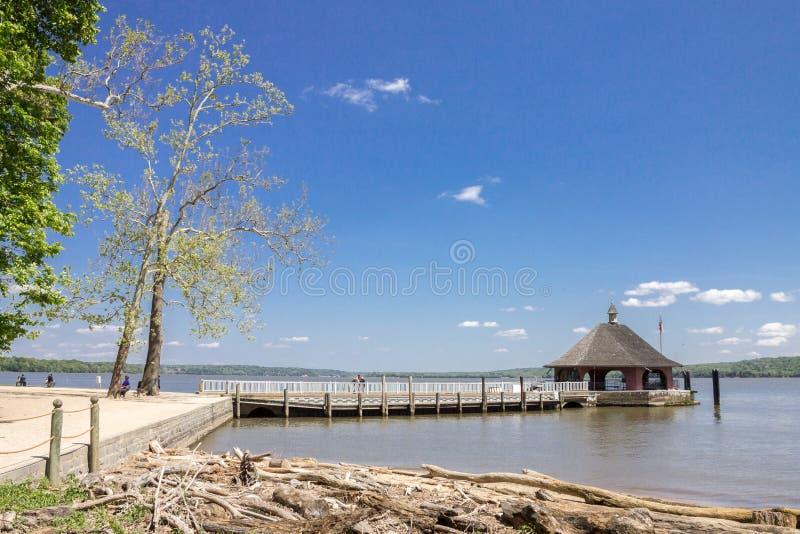 Potomac River Mount Vernon. A pier with a small hut at the shore of Potomac River in Mount Vernon plantation, Washington, United States stock photography