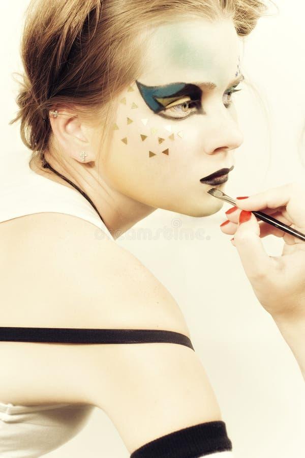 Potomstw model z jaskrawy makijażu jaskrawy makijażem zdjęcie stock