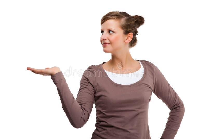 Młody atrakcyjny kobiety przedstawiać odizolowywam na białym tle zdjęcia royalty free