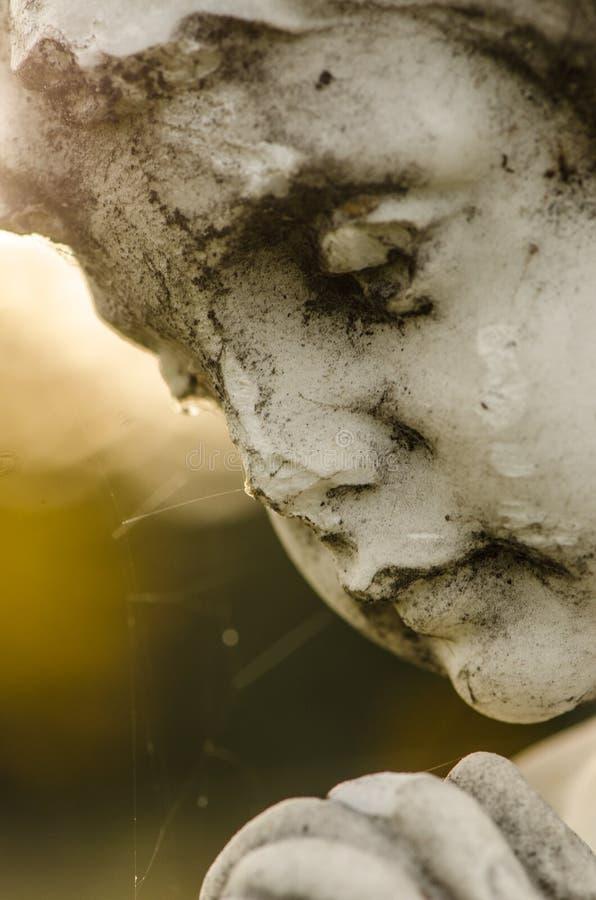 Potomstwo kamienia twarz aniołeczek zdjęcia royalty free