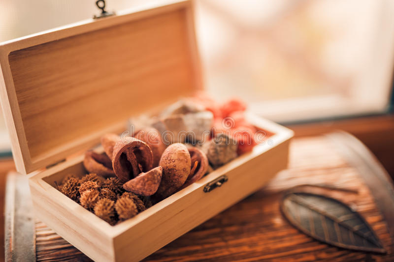 Potpourri. Colorful assorted potpourri in a bowl on a wooden box stock photography