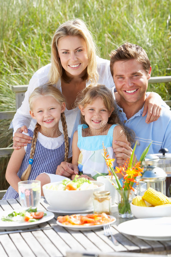 Potrait of family enjoying a meal outside stock photo