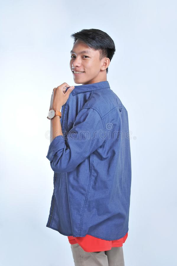 Potrait of handsome young asian model look at the camera with confident smiling royalty free stock photo
