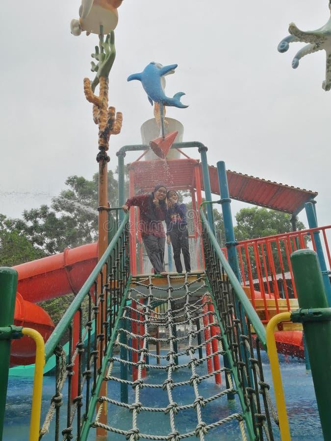 Potrait of two girls enjoying waterpark activities at Bayaou Lagoon Park at Melaka, Malaysia stock photo