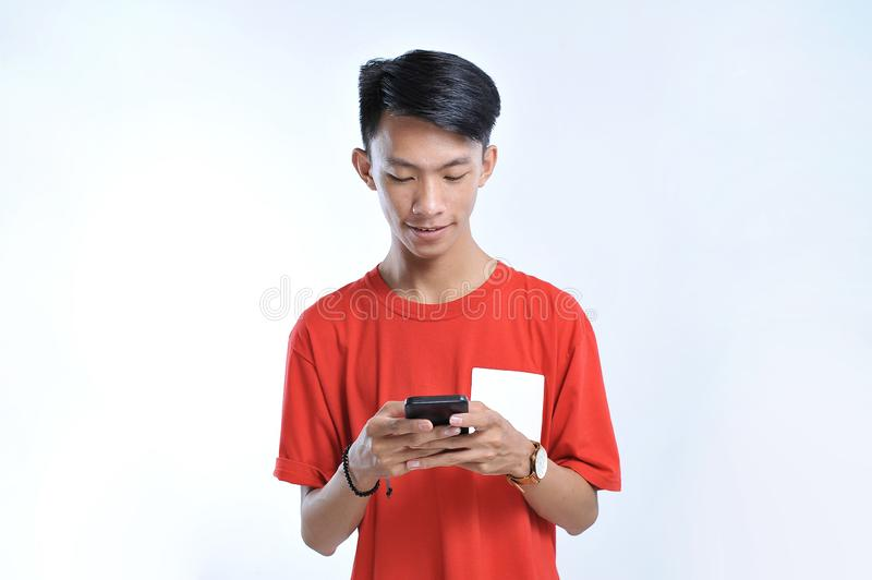 Portrait of a young student asian man talking on mobile phone, speak happy smile stock photos