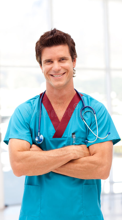 Potrait of a Young Doctor smilling at camera. In s hospital stock image