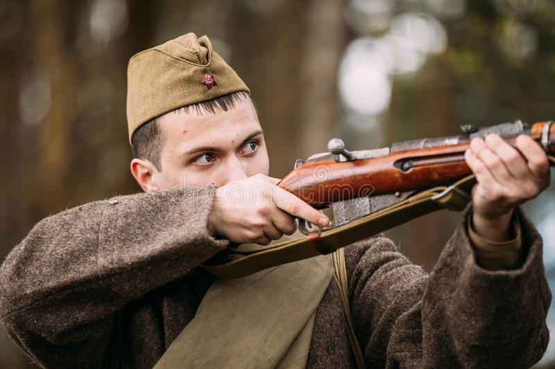Potrait Of Young Re-enactor Dressed As Russian Soviet Infantry S. Pribor, Belarus - April 23, 2016: Potrait Of Young Re-enactor Dressed As Russian Soviet royalty free stock photos