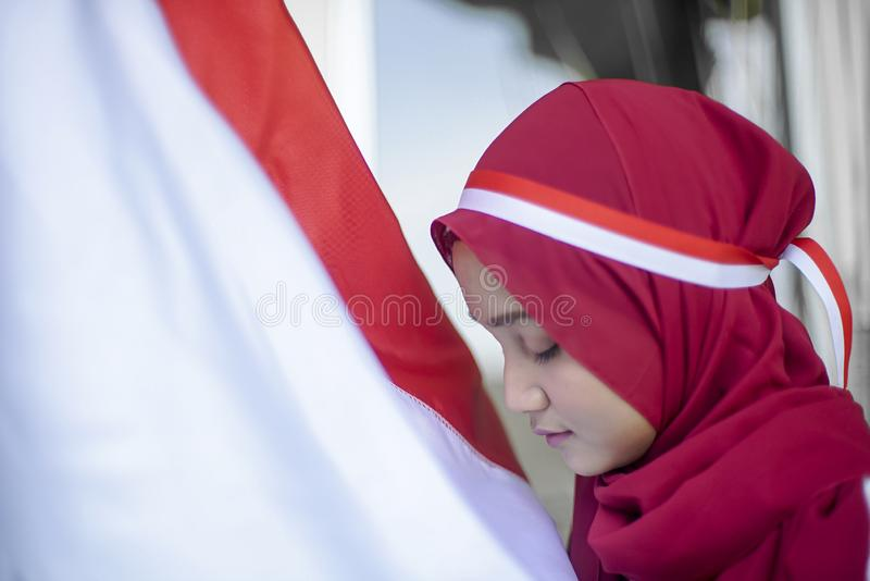 Potret Asian Girls with Indonesian flag, Indonesia independence day stock image
