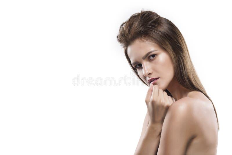 Potrtrait молодой женщины изолированное на белизне стоковые изображения