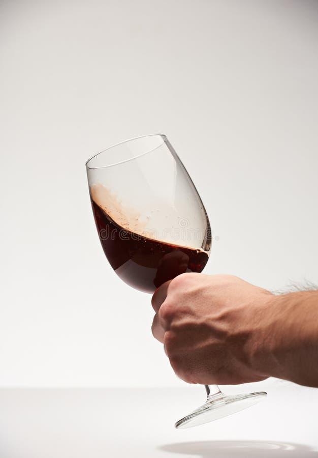 Potrząsalny czerwonego wina szkło zdjęcie royalty free