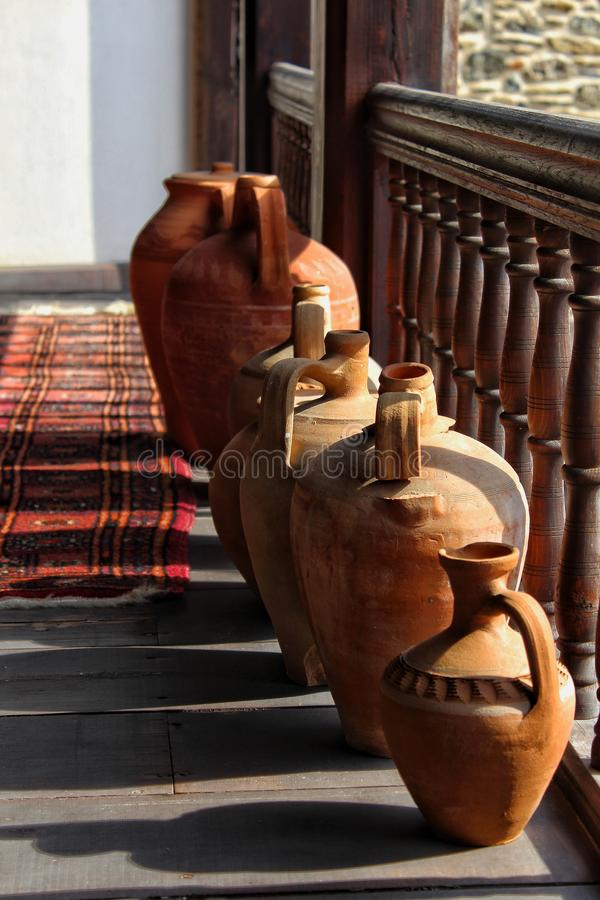 Water pots in the old place. Pots old place ancient antique water shadows brown vintagw vintage retro balcony design decoration interior stock image