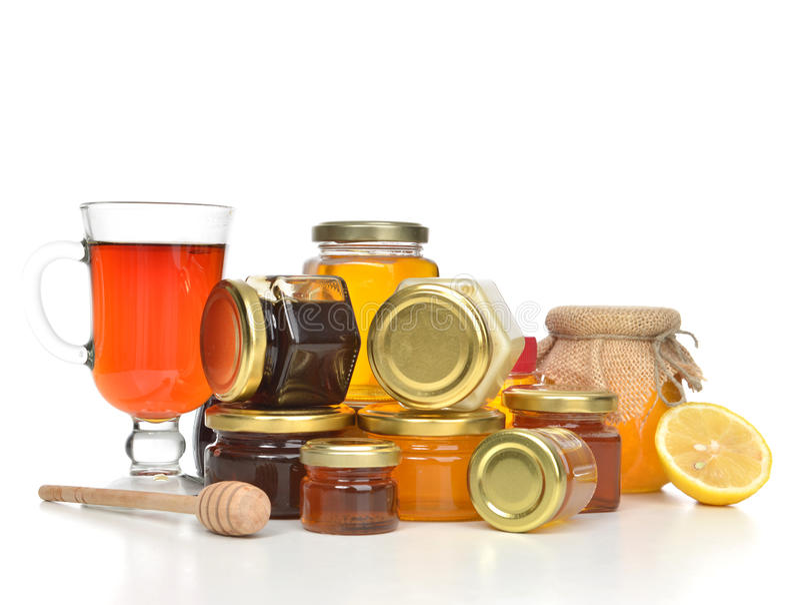 Pots savoureux de confiture et de citron et de thé crèmes de miel photographie stock
