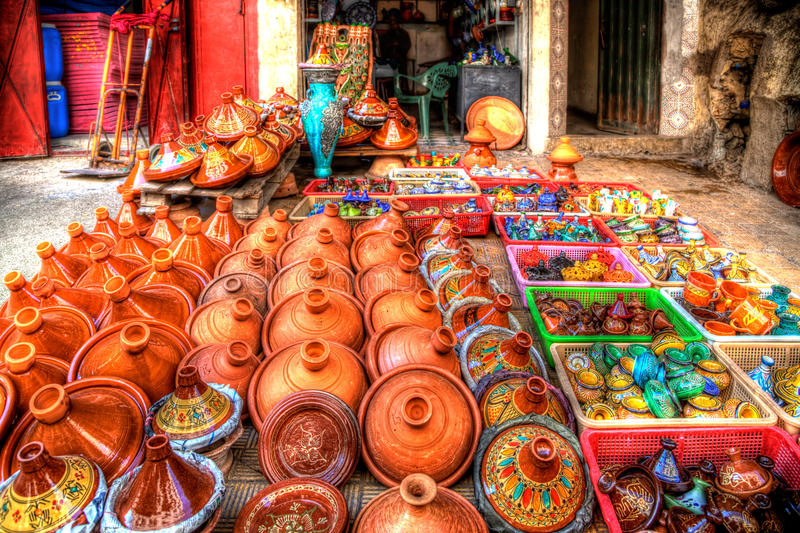 Pots of terra cotta and stoneware for the traditional delicious dishes Tajine and Couscous. With partially colorful decorative ornamental painting are exposed royalty free stock image