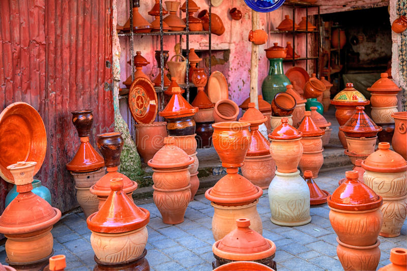 Pots of terra cotta and stoneware for the traditional delicious dishes Tajine and Couscous. With partially colorful decorative ornamental painting are exposed royalty free stock photography