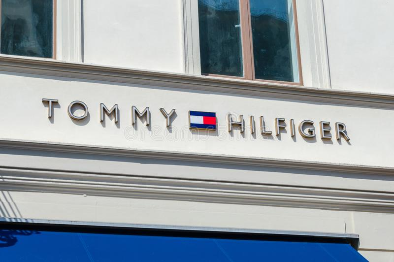 Logo and sign of Tommy Hilfiger. Potsdam, Germany - August 17, 2018: Logo and sign of Tommy Hilfiger American multinational corporation that designs and royalty free stock image
