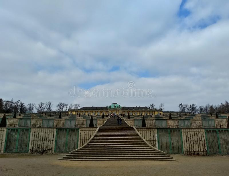 Potsdam / Germany - March 24 2018: Cascade of vineyards in the park Sans Souci. Palace Sans Souci in the distance royalty free stock photography
