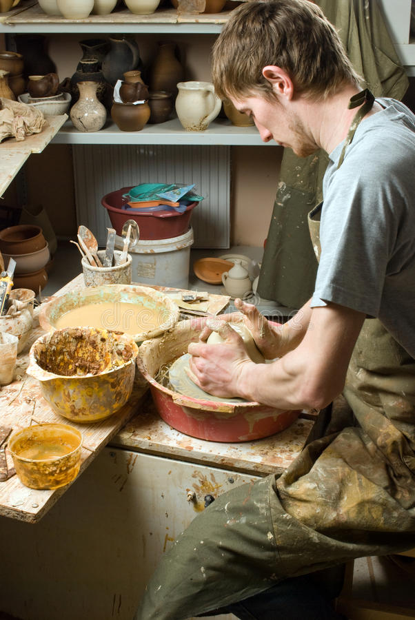 Potter, creating an earthen jar of white clay