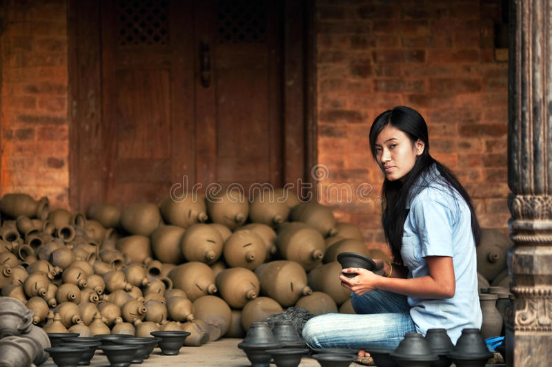 Potter girl, Nepal stock photo