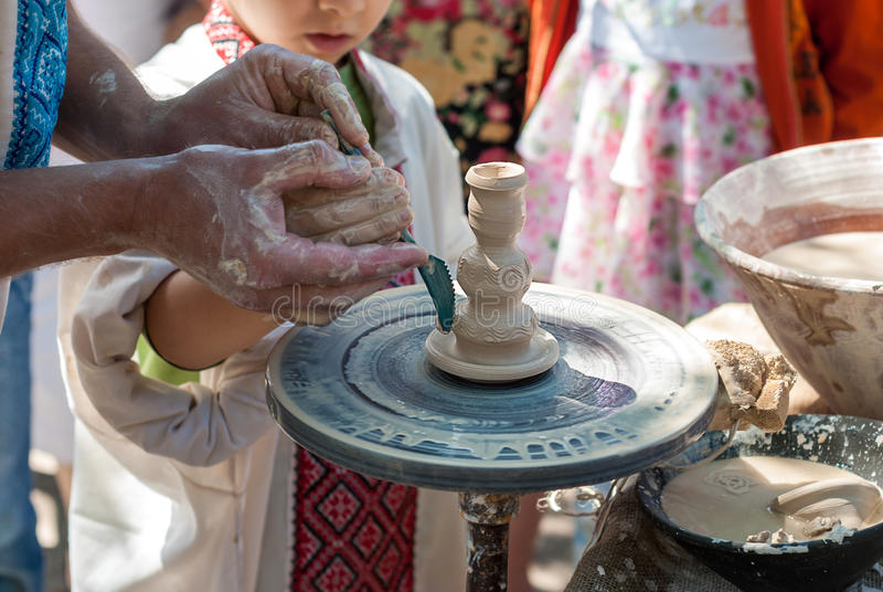 Download Potter guiding pottery editorial stock photo. Image of lesson - 37852403
