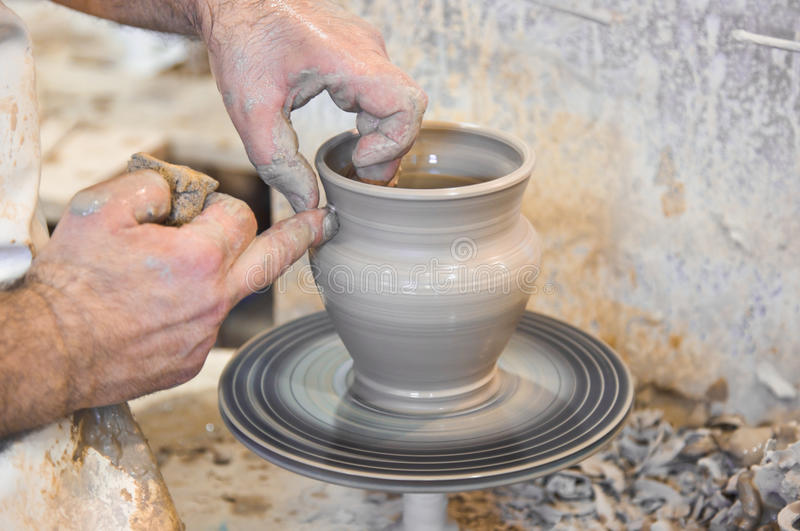 Potter hands and wheel. Potter hands and turning wheel royalty free stock photos