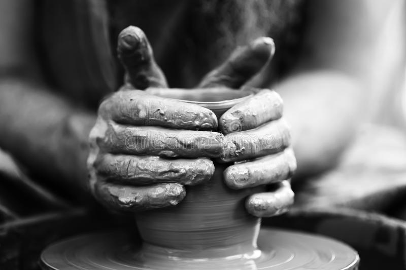 Potter making ceramic pot on the pottery wheel. Hands of a potter. Potter making ceramic pot on the pottery wheel royalty free stock photography