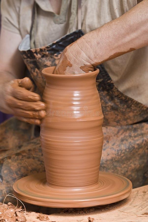 Potter making a pot. stock photography