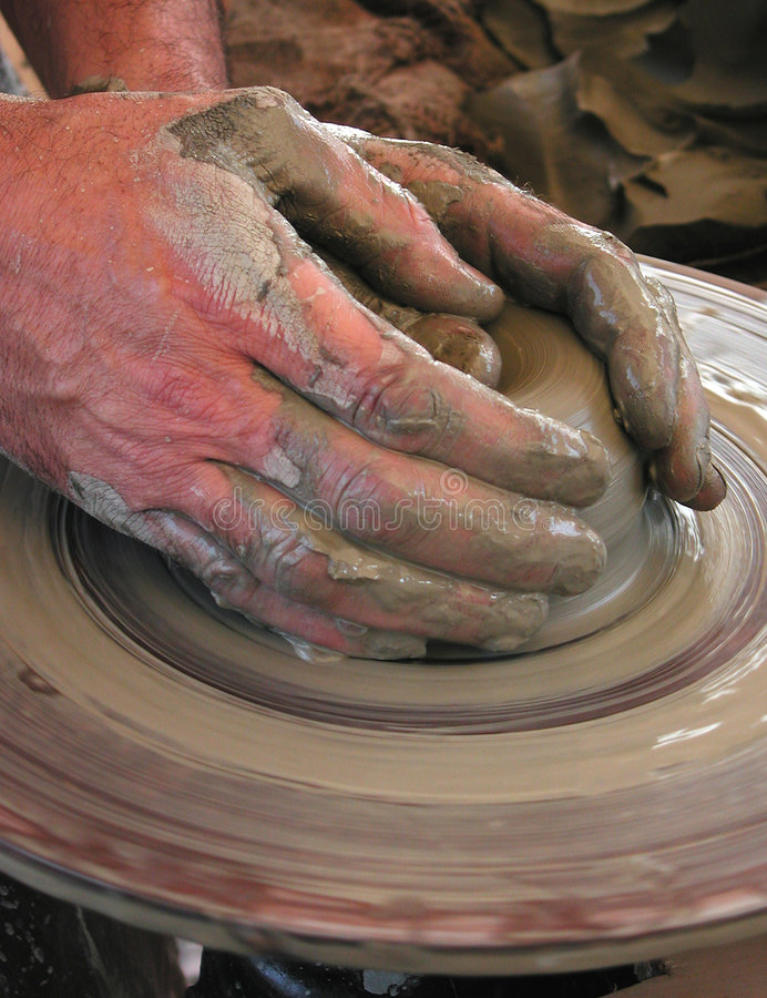 The potter's hands. Potter's hands at work