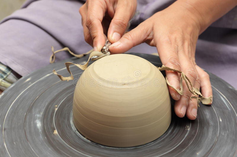 Potter's hands milling clay bowl royalty free stock photo