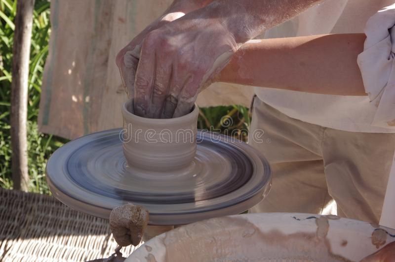 Potter`s wheel with clay. Hands potters make pottery on a potter`s wheel royalty free stock photos