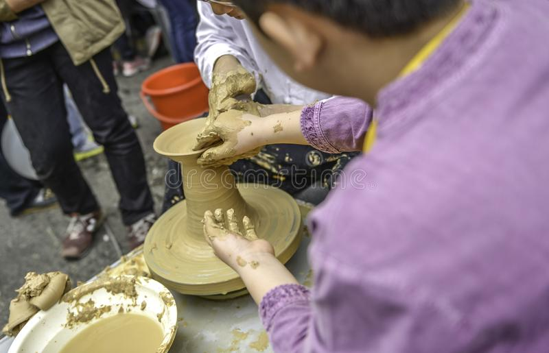 Potter teaching,Children learn to mold clay stock photography
