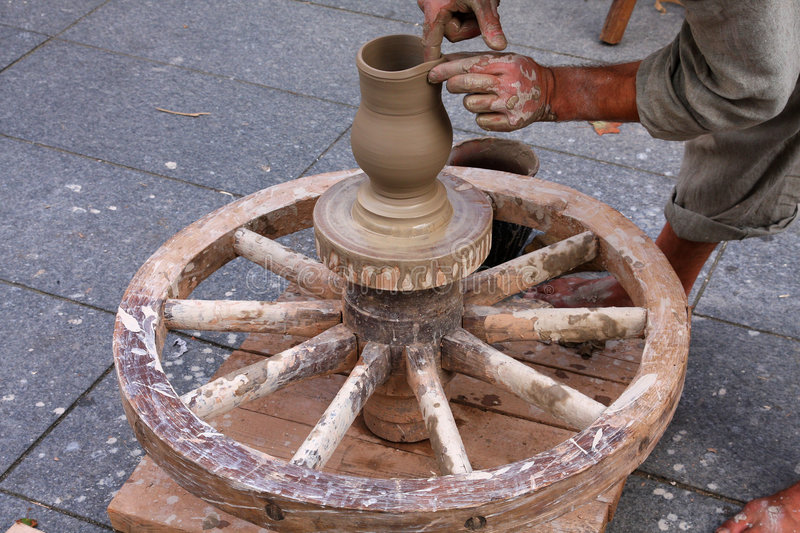 Potter using traditional wheel royalty free stock photography
