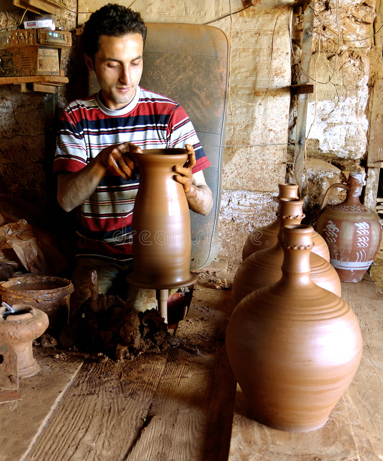 The potter working