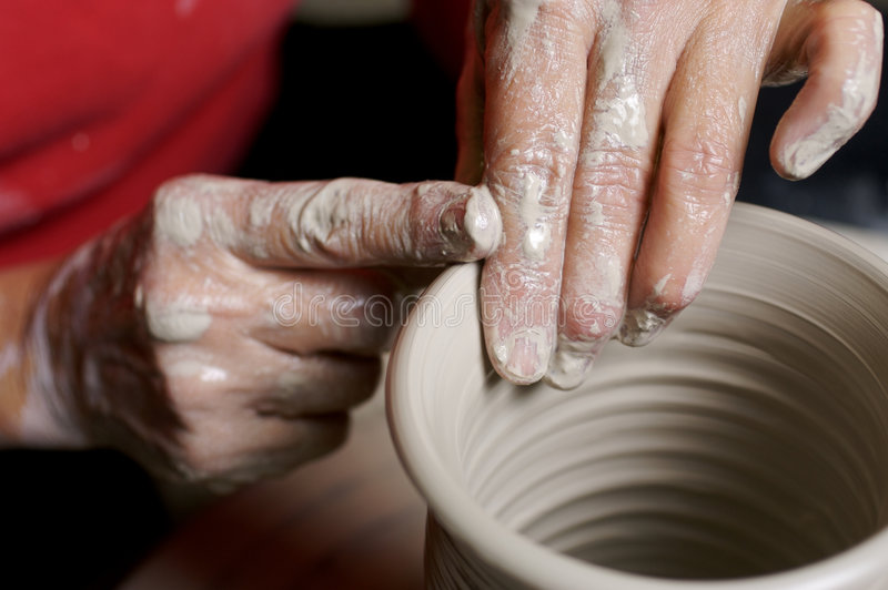 Potter working clay royalty free stock photography