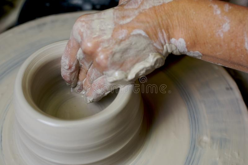 Potter working clay royalty free stock photo