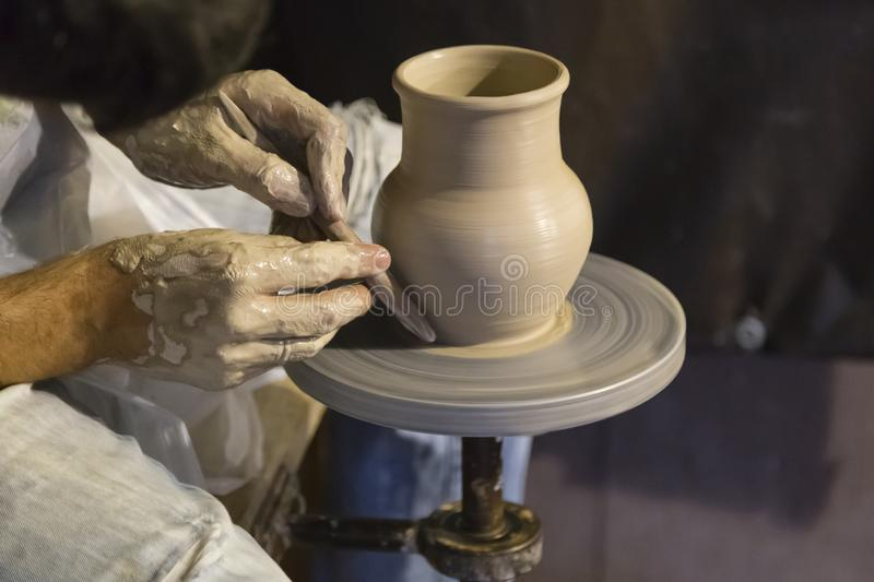 The potter works on the potter`s wheel royalty free stock photos