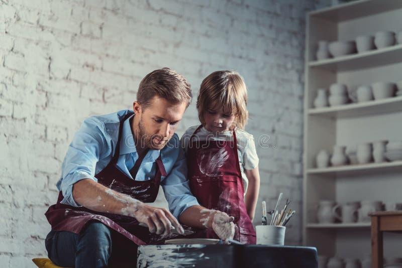 Potters in studio stock photos
