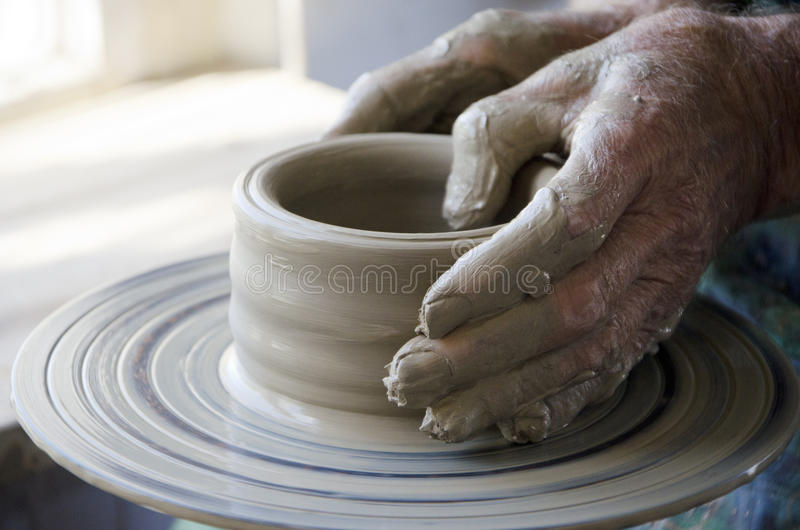 Pottery. The creation of pottery on wheel royalty free stock photography